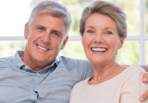 Mature Caucasian Couple Smiling at Camera